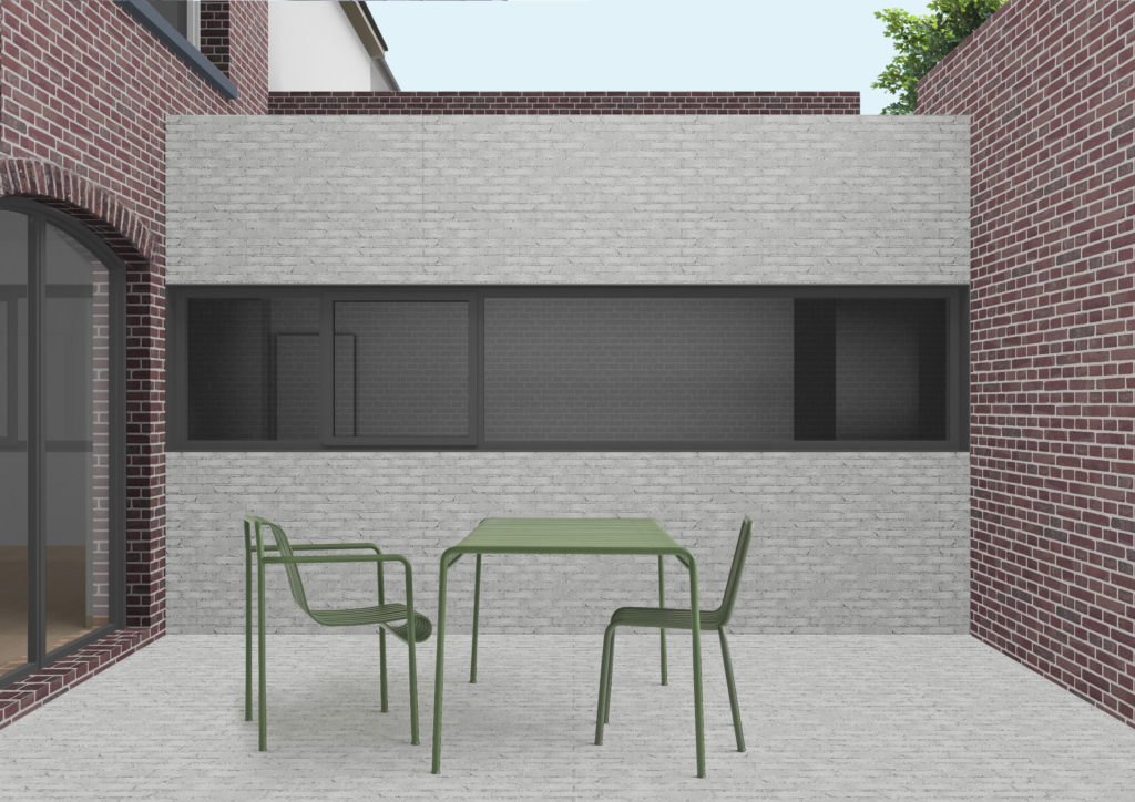 le revêtement de sol et la façade de l'annexe sont construits en brique claire, comme le reste des murs de la cour du projet